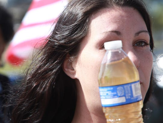 Jessica Owens of Flint holds a bottle of water from
