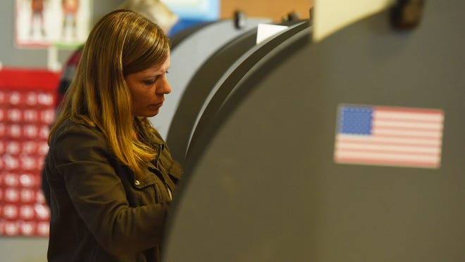 Caroline Cardone, 46, of the Town of Fishkill looks over her ballot at Fishkill Elementary School.