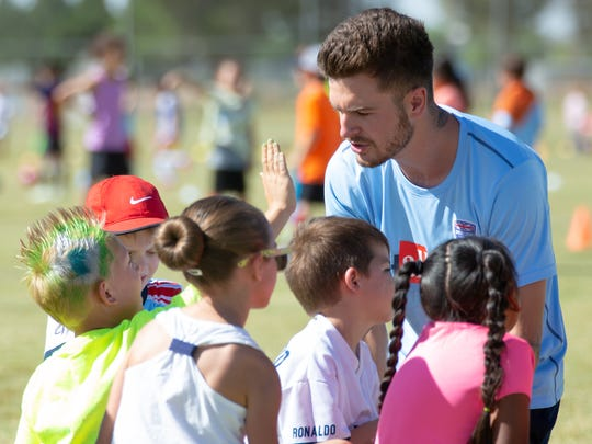 Challenger British Soccer Camp coach Kyle Cotter works with his five and six-year-old players on Thursday, May 31, 2018, during camp at High Noon Soccer Complex.