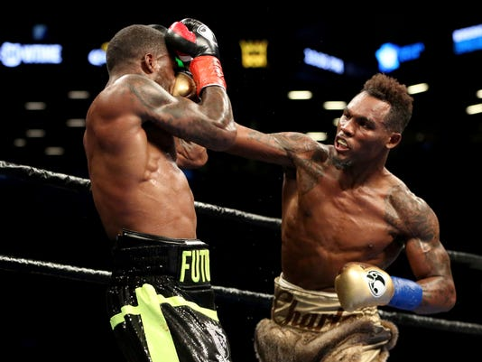 FILE - In this April 22, 2017, file photo, boxer Jermell Charlo, right, punches Charles Hatley during their WBC World super welterweight title fight in New York. Charlo will face No. 1 contender Erickson Lubin on Saturday at the Barclays Center in New York. (AP Photo/Gregory Payan, File)