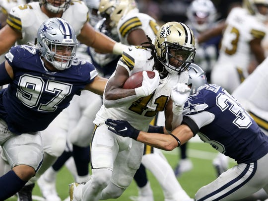 Sep 29, 2019; New Orleans, LA, USA; New Orleans Saints running back Alvin Kamara (41) is tackled by Dallas Cowboys strong safety Jeff Heath (38) in the second half at the Mercedes-Benz Superdome. Mandatory Credit: Chuck Cook-USA TODAY Sports