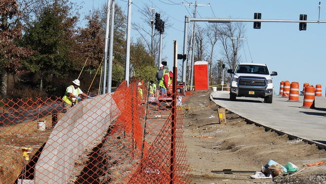 Forsgren Construction crews work along the newly opend Massard Road south-bound lane, Tuesday, Dec. 1, in Chaffee Crossing.