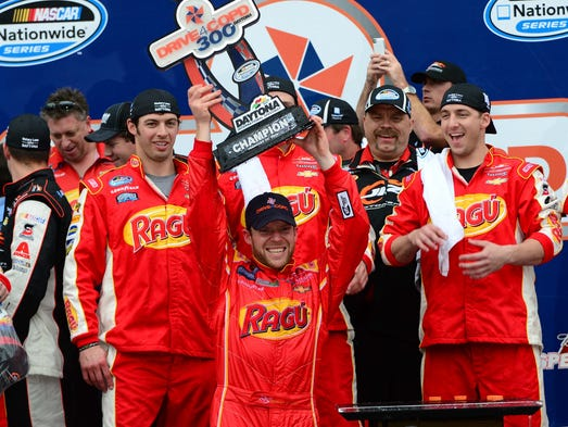 Regan Smith celebrates with his JR Motorsports crew after winning the DRIVE4COPD 300 Nationwide Series race Saturday at Daytona International Speedway.