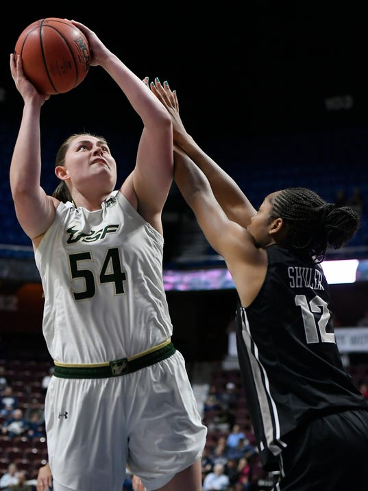 South Florida's Alyssa Rader, left, shoots over Central Florida's Nyala Shuler , right, during the first half of an NCAA college basketball game in the American Athletic Conference tournament semifinals at Mohegan Sun Arena, Monday, March 5, 2018, in Uncasville, Conn. (AP Photo/Jessica Hill)