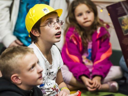 Lauren Seadorf, 10, intently listens to a teacher read