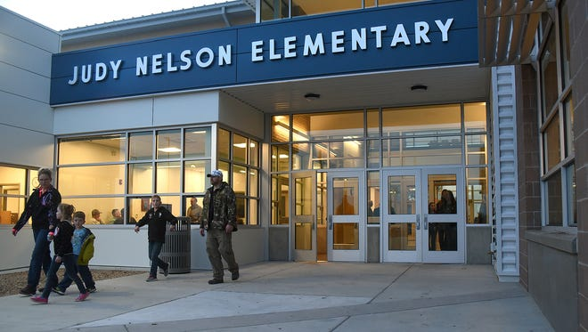 Students and parents visit the new Judy Nelson Elementary School for an orientation on Wednesday in Kirtland.