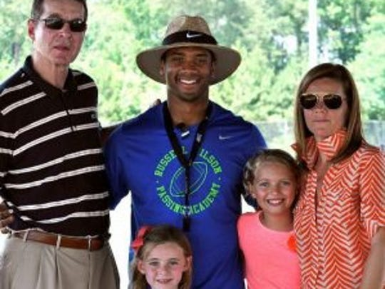 Russell Wilson with the Horton family.