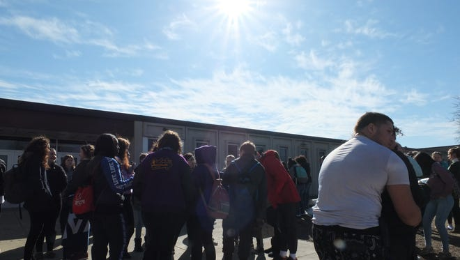 Students gather outside Cudahy High School the morning of March 14 during the national walkout in support of the victims of the Parkland shooting a month prior. That evening, Cudahy school administrators learned of an alleged threat against two Cudahy Middle School students.