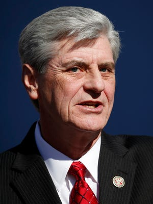 Mississippi Gov. Phil Bryant delivers his inaugural address after being sworn in for his second term of office, Tuesday, Jan. 12, 2016, on the south steps of the state Capitol in Jackson, Miss.