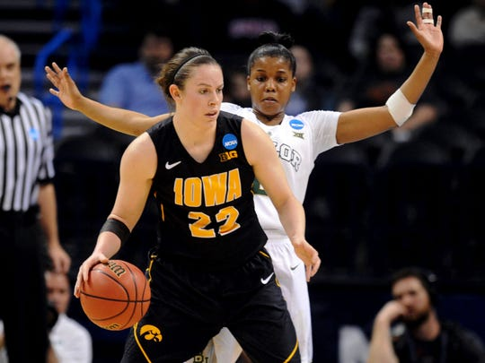 Iowa's Samantha Logic, a Racine Case product, handles the ball during the first half of a regional semifinal game against Baylor in the 2015 NCAA Tournament at Chesapeake Energy Arena in Oklahoma City. Logic posted a triple double in her final game of her college career.