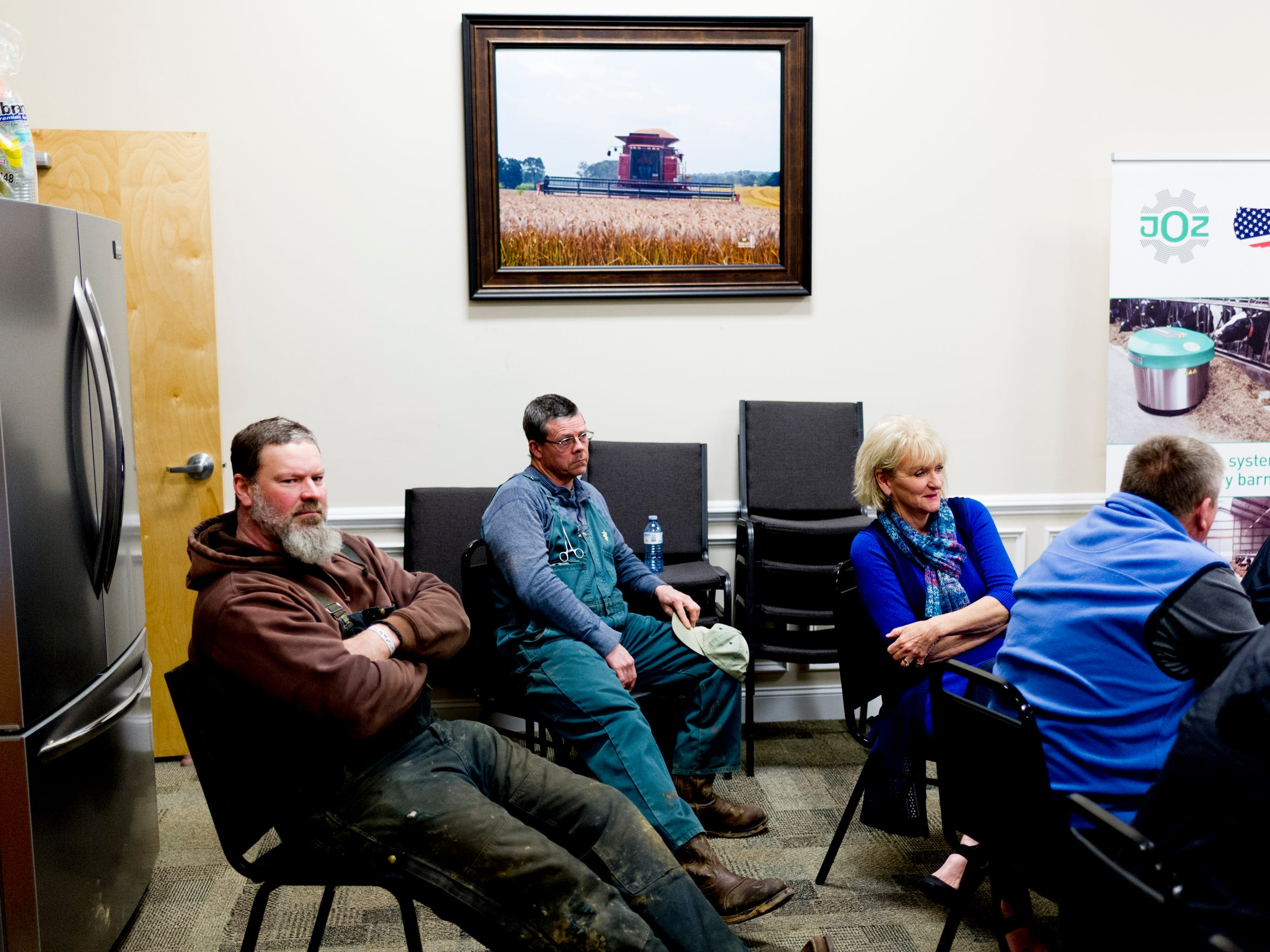 Attendees listen during a meeting at the AgCentral