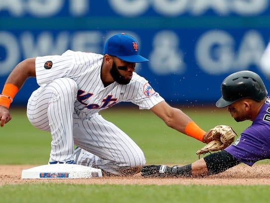 New York Mets shortstop Amed Rosario (1) tags out Colorado
