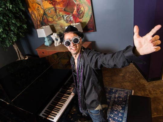 Daniel Sage, a performer and pianist, poses at the Flatrock Playhouse Downtown in Hendersonville, dressed as Elton John, Thursday, May 31, 2018. Sage has a summer concert series performing songs by Elton John, Billy Joel, Van Morrison, James Taylor and the Eagles.