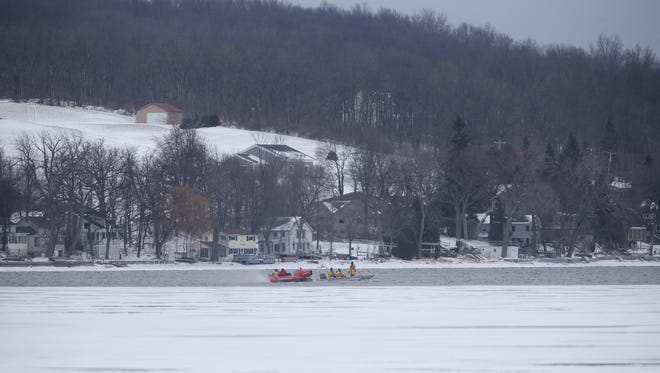 Crews search in the frigid waters of Conesus Lake on Feb. 13, 2017 for two people believed to have fallen through the ice.