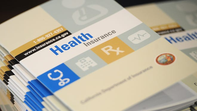 Booklets that show health insurance options for Californians.