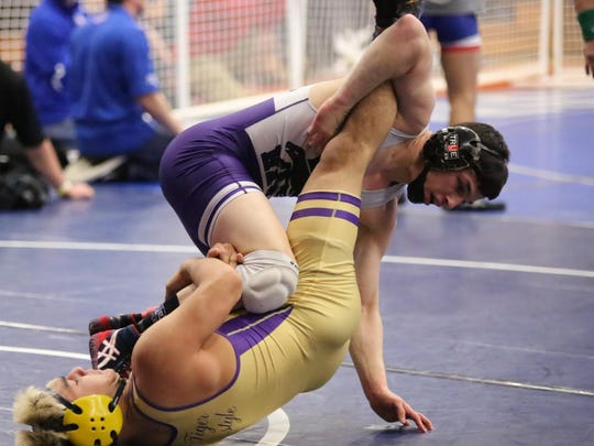 Mission Oak's Jaden Enriquez grapples with Lemoore's Joe Romero in a semifinal match on Feb. 18 at the Central Section Yosemite Divisionals in Bakersfield. Enriquez won 11-4.
