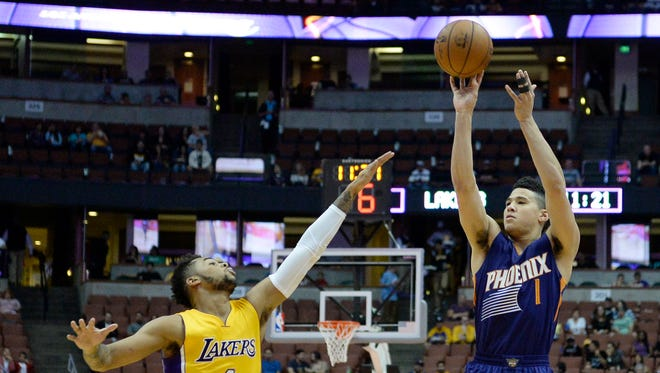 Oct 21, 2016: Phoenix Suns guard Devin Booker (1) shoots over Los Angeles Lakers guard D'Angelo Russell (1) during a preseason NBA game at Honda Center.
