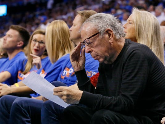 FILE - This April 21, 2017 file photo shows Leslie Alexander, owner of the Houston Rockets, looking over a stat sheet during the third quarter of the team's first-round NBA basketball playoff game against the Oklahoma City Thunder in Oklahoma City. Alexander has been fined $100,000 by the NBA for confronting a referee during live game action. Byron Spruell, the NBA's president of league operations, announced Alexander's fine Wednesday, April 26, 2017. (AP Photo/Sue Ogrocki)