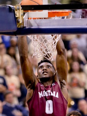 Montana's Michael Oguine dunks earlier this season in a nonconference game against Pittsburgh. Montana won 83-78 in overtime.