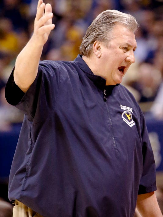 West Virginia coach Bob Huggins gestures as he talks to his team during the first half of an NCAA college basketball game against Pittsburgh, Saturday, Dec. 9, 2017, in Pittsburgh. West Virginia won 69-60. (AP Photo/Keith Srakocic)