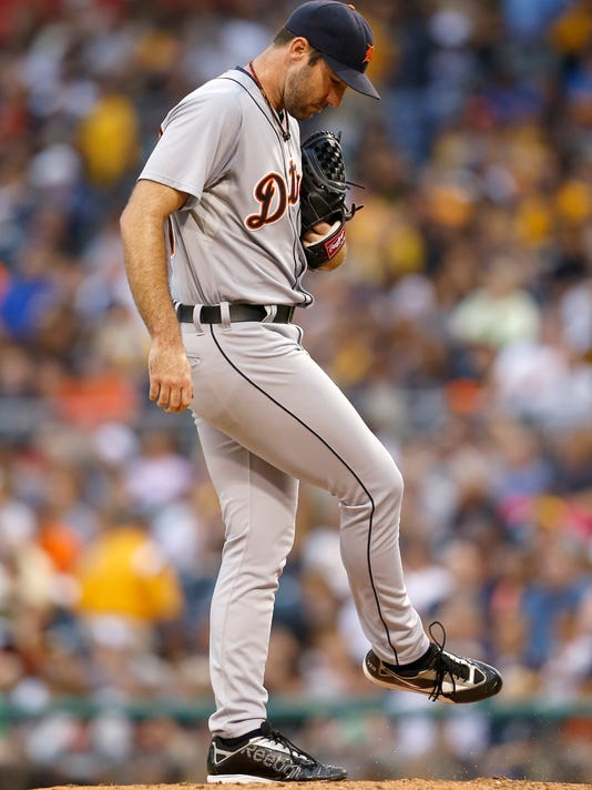 Detroit Tigers starting pitcher Justin Verlander kicks at the pitchers mound after the Pittsburgh Pirates scored five runs in the first inning of the baseball game on Monday, Aug. 11, 2014, in Pittsburgh. (AP Photo/Keith Srakocic)