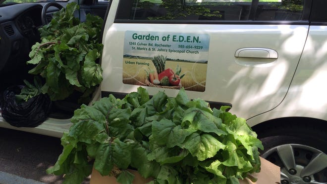 Fresh vegetables from E.D.E.N. Gardens wait to be delivered to food pantries.
