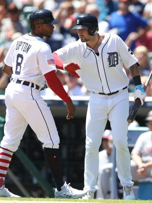 Detroit Tigers' Justin Upton is met by Nicholas Castellanos after scoring against the San Francisco Giants during fourth inning action Tuesday, July 4, 2017 at Comerica Park in Detroit, Mich. (Kirthmon F. Dozier/Detroit Free Press)