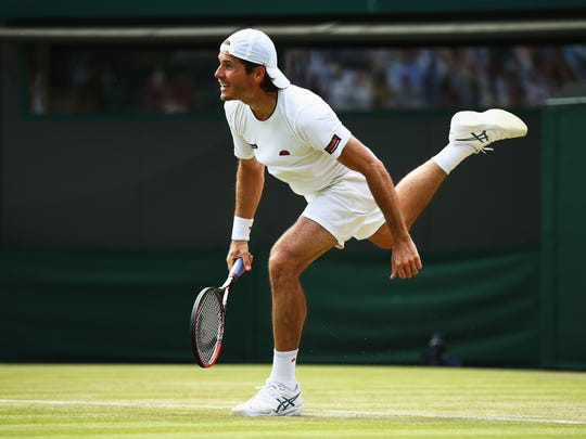 Tommy Haas serves to Milos Raonic at the Wimbledon Lawn Tennis Championships at the All England Lawn Tennis and Croquet Club on July 1, 2015 in London.
