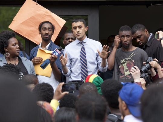 Camden school Superintendent Paymon Rouhanifard addresses students as they protest teacher layoffs, Wednesday, May 14, 2014 in Camden.