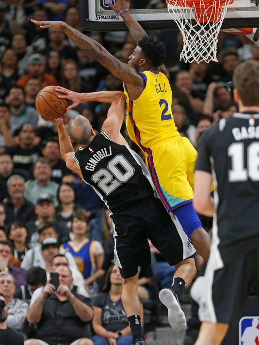 San Antonio Spurs guard Manu Ginobili (20) is fouled by Golden State Warriors center Jordan Bell (2) during the first half of an NBA game, Monday, March 19, 2018, in San Antonio. (AP Photo/Ronald Cortes)