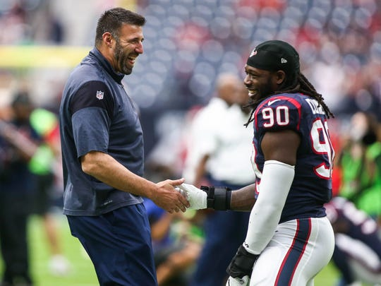 Sep 18, 2016; Houston, TX, USA; Houston Texans linebackers coach Mike Vrabel shakes hands with defensive end Jadeveon Clowney (90) before a game against the Kansas City Chiefs at NRG Stadium.