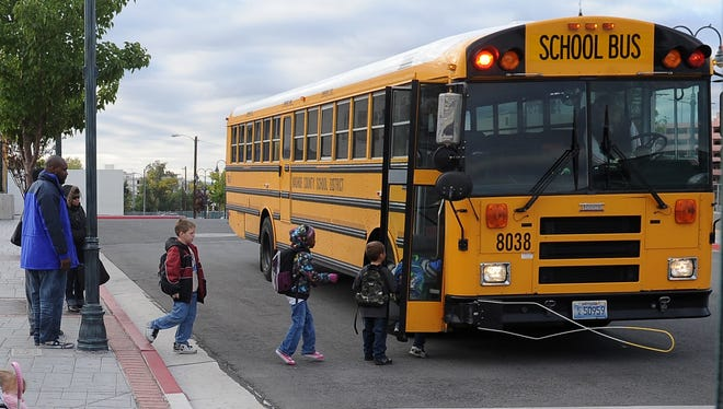 Students board a Washoe County School District bus.