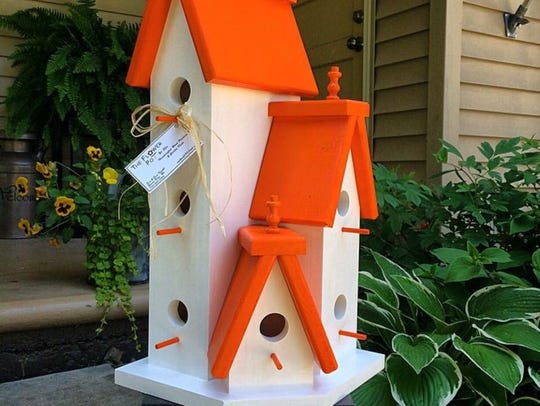 "Jen and Eric Kuehl make colorful wooden bird ""condos"""