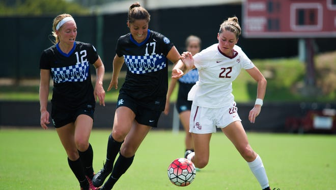 Florida State freshman midfielder Bella Dorosy (22) battles for possession against a pair of Kentucky defenders during the Seminoles 4-0 victory on Sunday afternoon at the Seminole Soccer Complex.