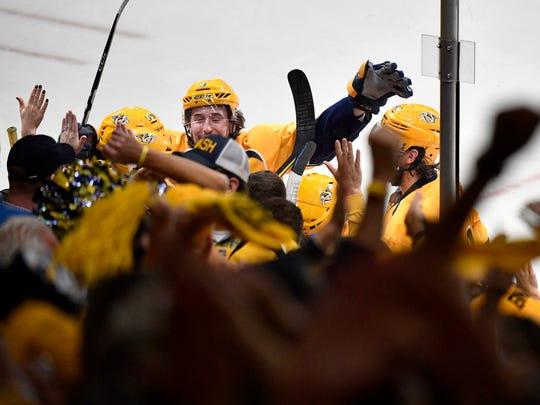 The Predators celebrate the winning goal by Nashville Predators right wing James Neal (18) during the third  period in game 4 of the second round NHL Stanley Cup Playoffs at the Bridgestone Arena Tuesday, May 2, 2017, in Nashville, Tenn.