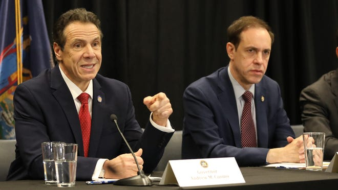 New York Governor Andrew Cuomo discusses the new cases of the Coronavirus in New Rochelle, during a press briefing at the New York Power Authority in White Plains, March 4, 2020. At left is George Latimer, the Westchester County Executive and at right is Howard Zucker, M.D. the NYS Health commissioner.