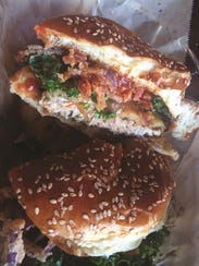 The #4 Chicken Burger with kale slaw, crispy red onions,