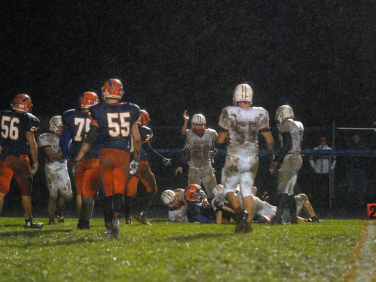 Port Clinton Redskins played a cold, muddy and slippery game at Edison High School in Milan, winning 21-14 on Friday.