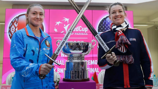 United States Fed Cup team member CoCo Vandeweghe, right, and Belarus' team player Aliaksandra Sasnovich pose for a photo after drawing ceremony for the Fed Cup.