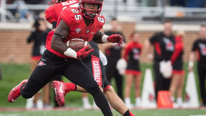 Ball State's Darian Green makes a run during the game Saturday afternoon at Scheumann Stadium. Ball State lost to NIU 31-24.