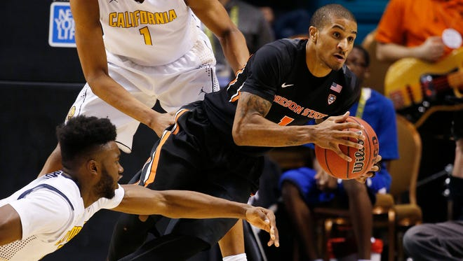 Oregon State guard Gary Payton II, right, drives around California forward Jaylen Brown, left, during the second half of an NCAA college basketball game in the quarterfinal round of the Pac-12 men's tournament Thursday, March 10, 2016, in Las Vegas. California won 76-68. (AP Photo/John Locher)