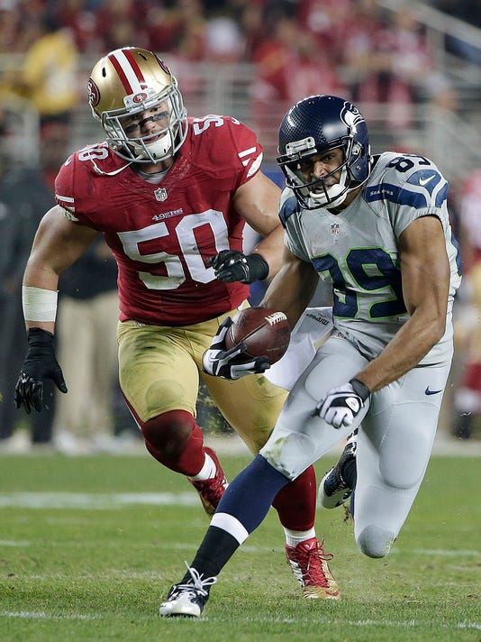 FILE - In this Thursday, Nov. 27, 2014, file photo, Seattle Seahawks wide receiver Doug Baldwin (89) runs from San Francisco 49ers inside linebacker Chris Borland (50) during the first quarter of an NFL football game in Santa Clara, Calif. The 49ers announced late Monday, March 16, 2015, that Borland is retiring after one season, without offering specifics. (AP Photo/Marcio Jose Sanchez, File)