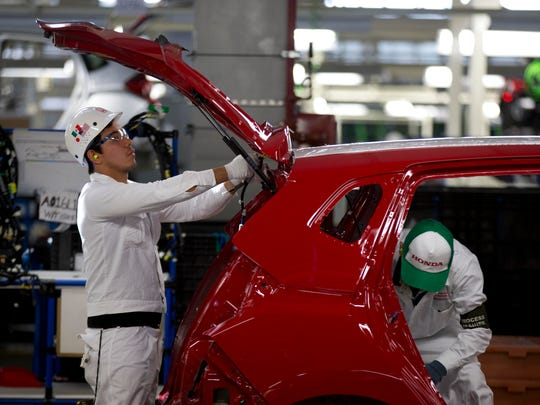 Employees at work in the multibillion-dollar Honda car plant in Celaya, in the central Mexican state of Guanajuato.
