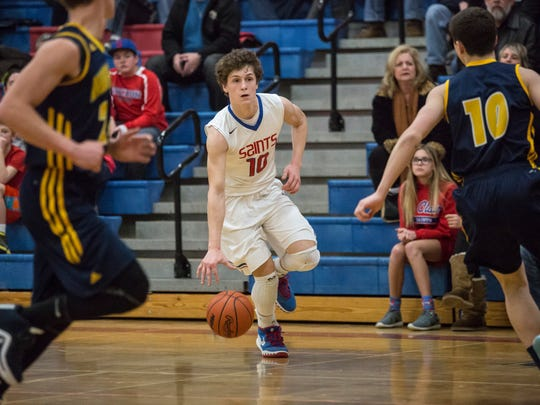 St. Clair sophomore Ben Davidson drives the ball down court during a basketball game Wednesday, March 2, 2016 at St. Clair High School.