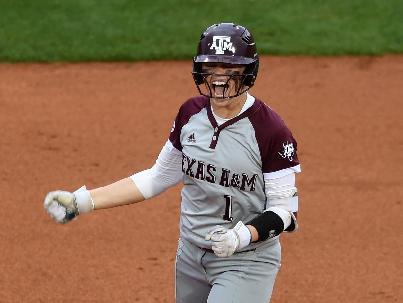 Texas A&M's Samantha Show (1) celebrates on second base during an NCAA Super Regional game between Tennessee and Texas A&M at Sherri Parker Lee Stadium on Saturday, May 27, 2017. Texas A&M defeated Tennessee 6-5.