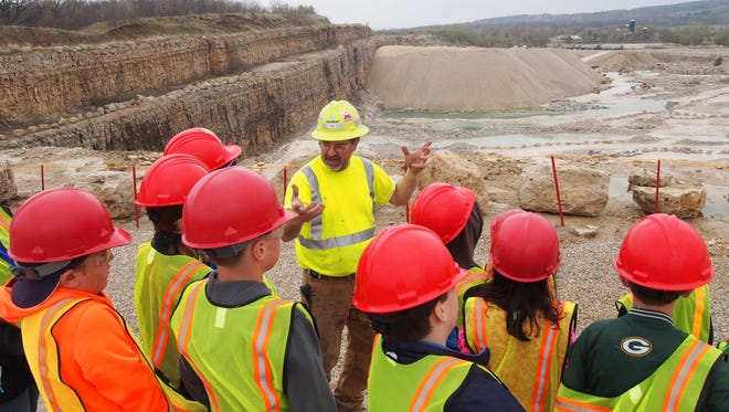 Tom Caves discusses operations in the Marblehead Quarry in Eden with students who toured it this past spring. Caves is employed by Graymont, which owns the quarry. Michels Materials, Graymont and Eden Stone work together to offer the free tours to hundreds of area students each year.
