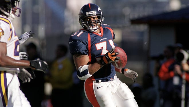In this Oct. 31, 1999, file photo, Derek Loville #31 of the Denver Broncos carries the ball during the game against the Minnesota Vikings at the Mile High Stadium in Denver, Colorado. The Vikings defeated the Broncos 23-20.