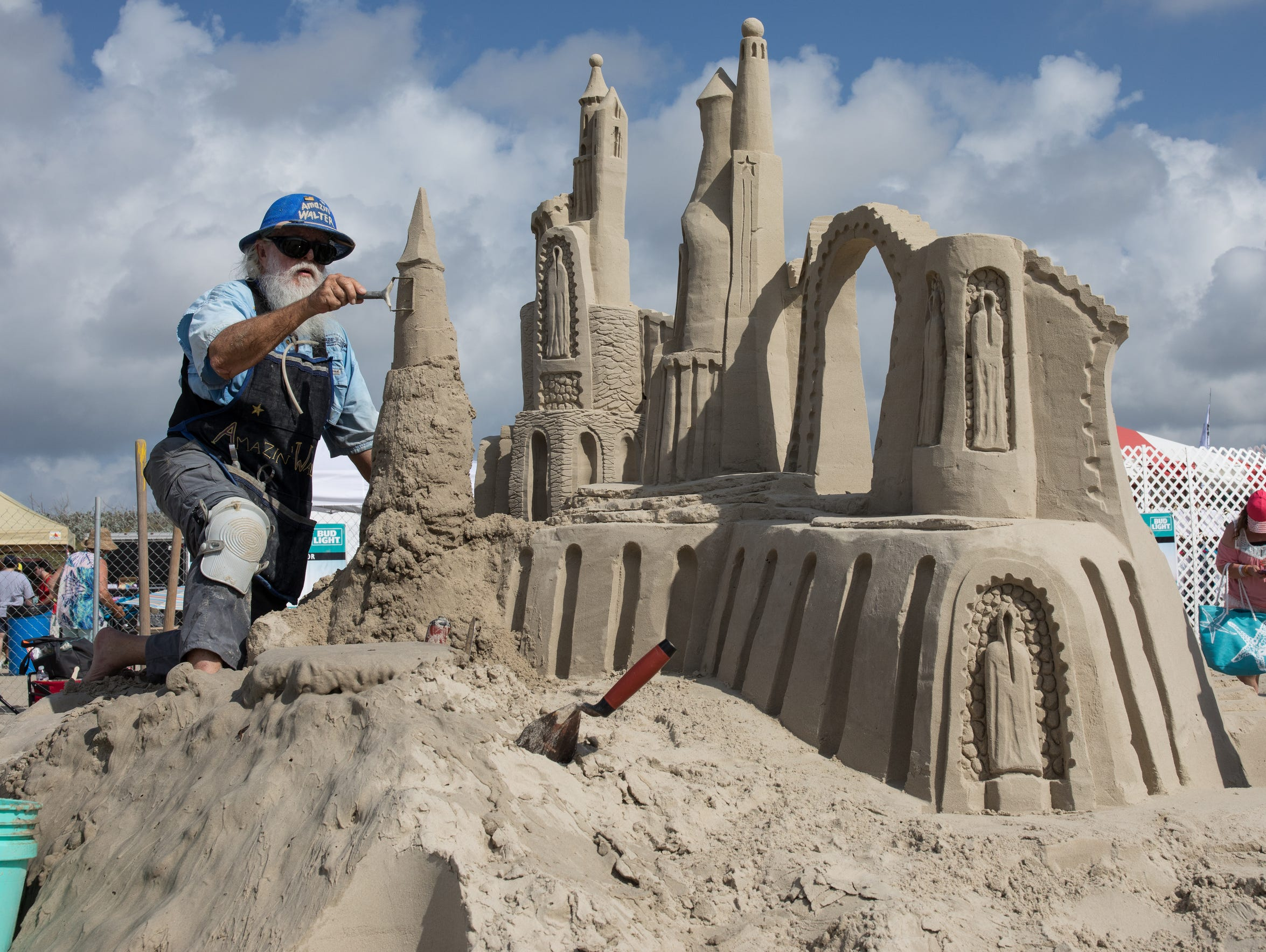 Walter McDonald of South Padre Island constructs a sand sculpture Texas SandFest 2017. The competition is one of Port Aransas' signature events, bringing thousands of tourists into town.