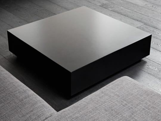 Black square coffee-table, modern interior detail