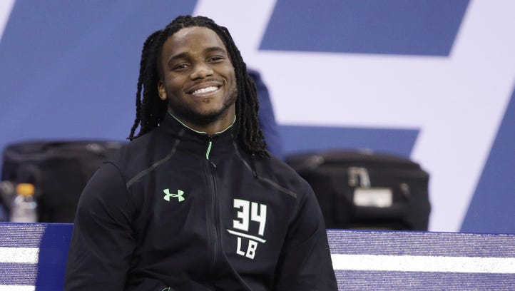 In this Feb. 28, 2016 file photo, Notre Dame linebacker Jaylon Smith watches during drills at the NFL football scouting combine, in Indianapolis. Smith is sharing his journey with fans through a 360-degree virtual reality video. Smith was viewed as a certain top-10 NFL draft choice before he tore up his left knee in the Fiesta Bowl.